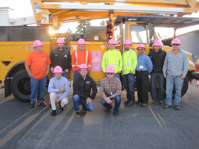Lakeview Light & Power crews wearing pink hard hats in honor of Breast Cancer Awareness month